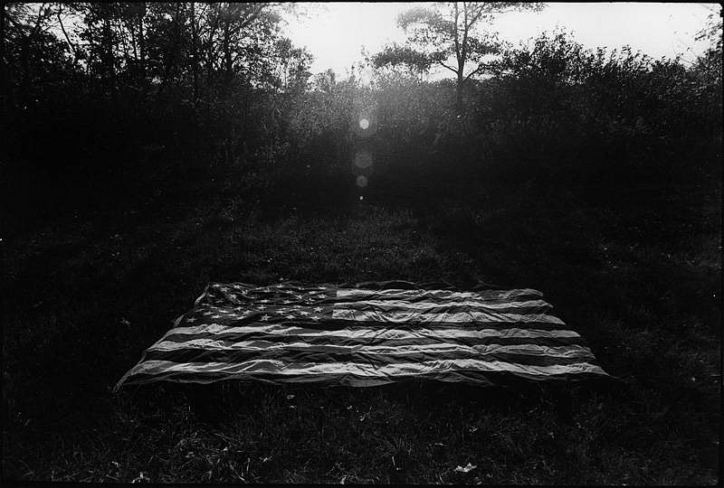Robert D'Alessandro ,   Hank's Flag, Eastport, New York  ,  1969     Vintage gelatin silver print ,  11 9/16 x 17 3/16 in. (29.4 x 43.7 cm)     3509     Price Upon Request