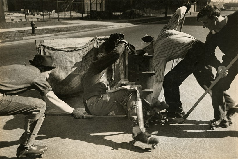 Eliot Elisofon ,   Hockey players use the street for a rink, cardboard as shinguards, from Playgrounds for Manhattan  ,  1938     Vintage gelatin silver print ,  9 1/16 x 13 3/8 in. (23 x 34 cm)     6074