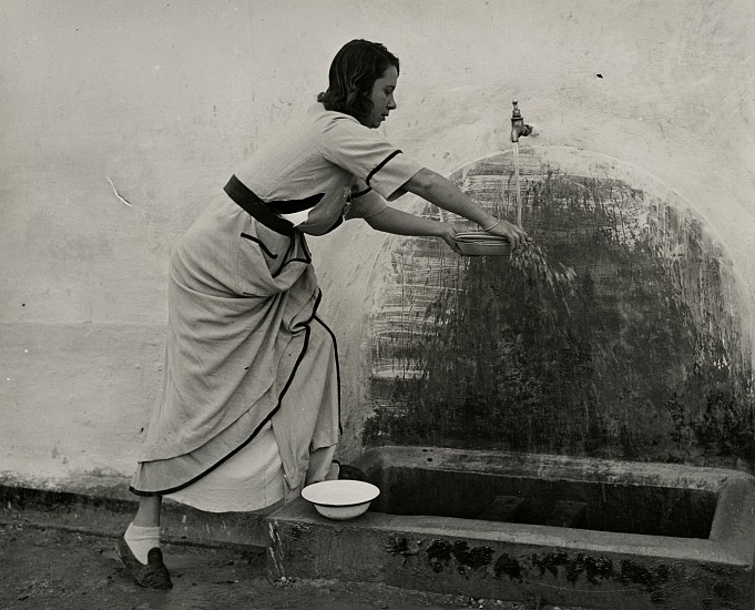 Eliot Elisofon ,   Concentration Camp in French Morocco  ,  1942     Vintage gelatin silver print ,  7 1/216 x 9 1/4 in. (17.8 x 23.5 cm)     Italian Woman at Water Faucet in Courtyard.