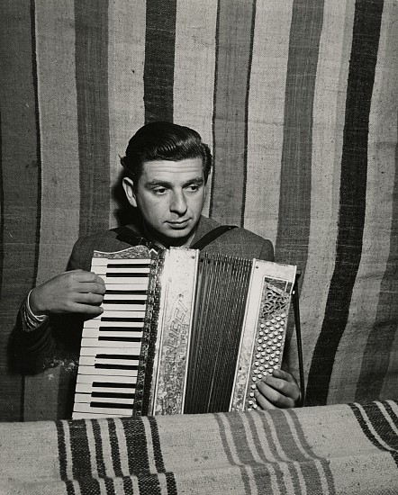 Eliot Elisofon ,   Concentration Camp in French Morocco  ,  1942     Vintage gelatin silver print ,  9 1/4 x 7 7/16 in. (23.5 x 18.9 cm)     Camp Doctor Landesberg plays accordion for accompaniment.
