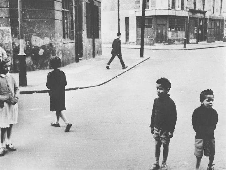Roger Mayne ,   Group, Southam Street Corner, North Kensington, London  ,  1957     Vintage gelatin silver print ,  10 3/4 x 14 in. (27.3 x 35.6 cm)     1020     Sold