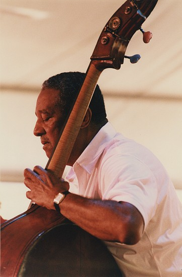 Paul J. Hoeffler ,   Ray Brown, Toronto Jazz Festival, at 'The Tent'  ,  1994     Chromogenic print ,  14 x 11 in. (35.6 x 27.9 cm)     Ray Brown (1926-2002) was a bassist known for extensive work with Oscar Peterson and Ella Fitzgerald, and as one of the greatest bassists in jazz history. Signed by the photographer.     7392     Sold