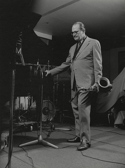 Paul J. Hoeffler ,   Al Cohn  ,  1987     Gelatin silver print; printed later ,  11 x 14 in. (27.9 x 35.6 cm)     A musician-insider, Al Cohn (1925-1988) was a tenor saxophonist who came to prominence in Woody Herman's big band - also known for his longtime musical partnership with fellow saxophonist Zoot Sims.  Signed by the photographer.      7373     $300